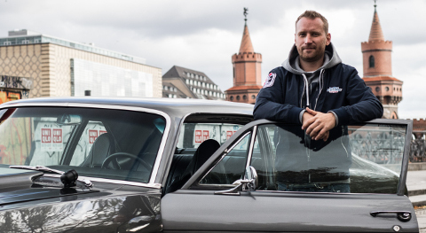 Björn Morhin with his Nova in front of the Oberbaum bridge in Berlin.